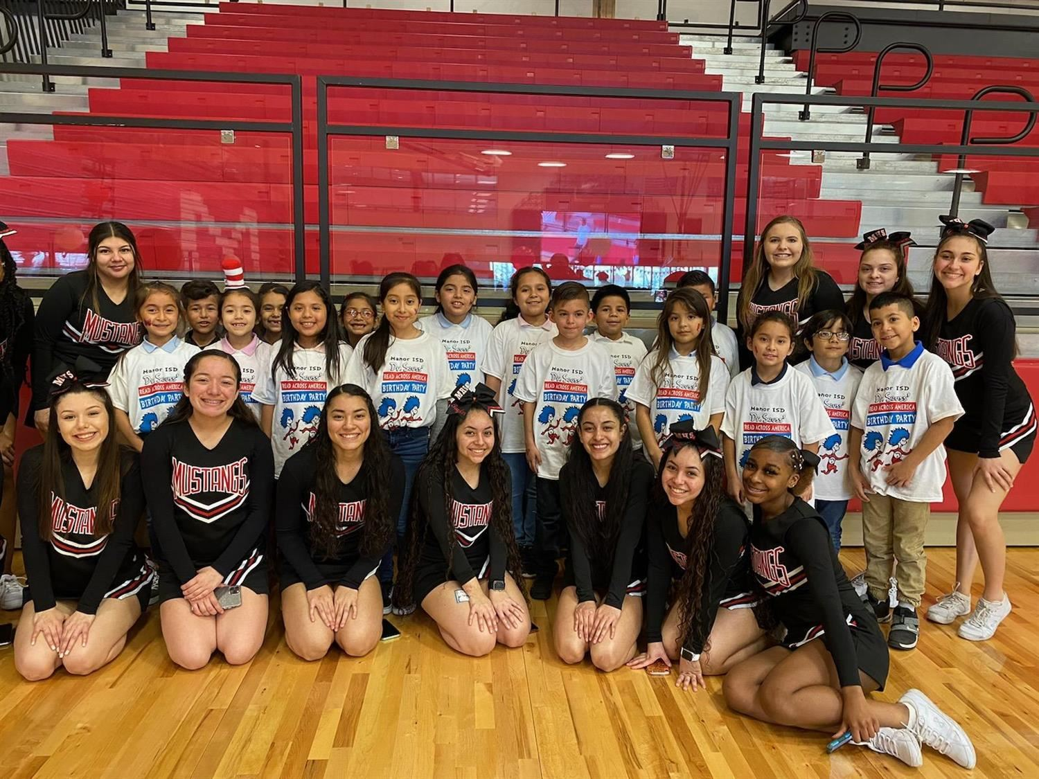 Ms. Moreno's class poses with MHS cheerleaders