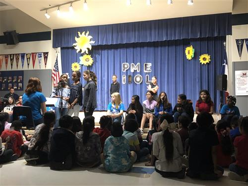The PME Choir sings at the talent show.