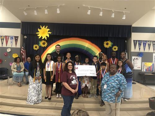 2019 NEHS presented a check to  Decker Middle School to help with Food Backpacks for Kids.